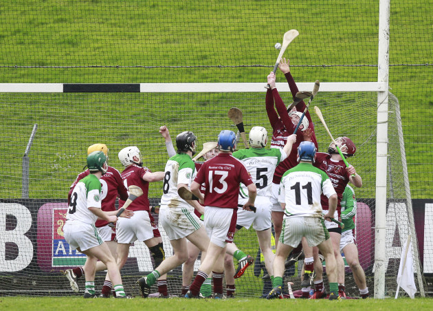Cushendall players try to prevent a Sarsfields goal