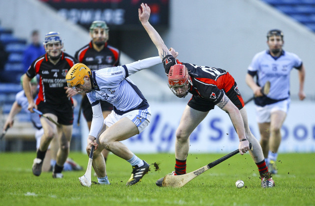Anthony Roche in action against Na Piarsaigh's David Dempsey