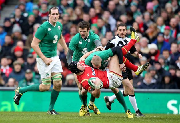 Keith Earls tackles Tom James