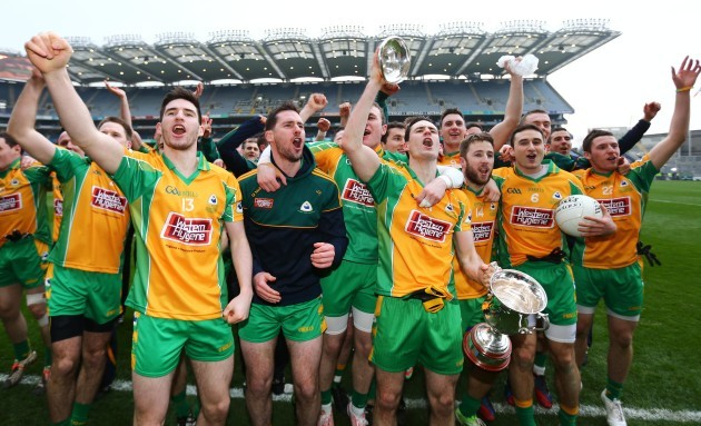 Corofin players celebrate with the cup after the game