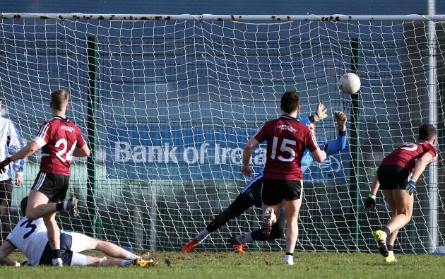 Ryan McNulty shoots past UUJ goalkeeper Sean Fox to score a goal