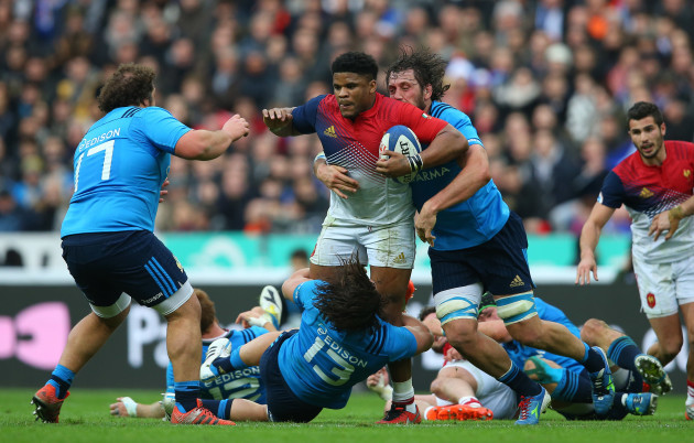 France's Jonathan Danty is tackled by Italy's Michele Campagnaro and Valerio Bernabo