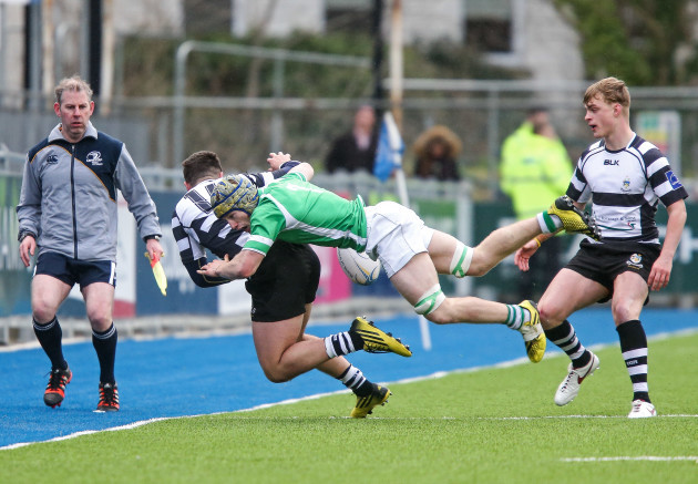 Jack MacNamara tackles Daniel Keane