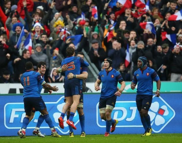 Maxime Medard celebrates his try with Maxime Machenaud and teammates