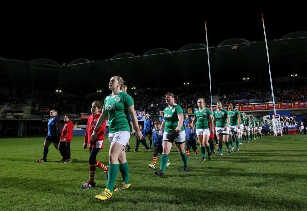 Niamh Briggs leads out her team