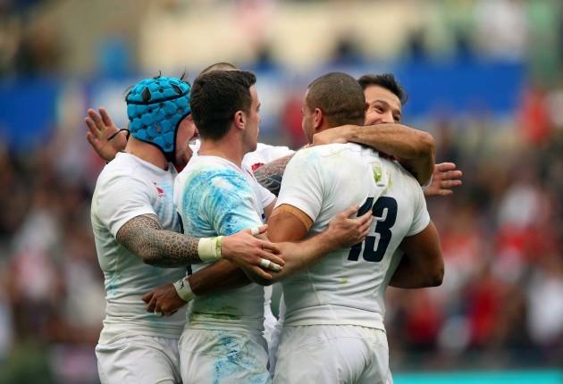 Jonathan Joseph celebrates his try with teammates