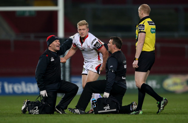 Stuart Olding leaves the field after a head injury