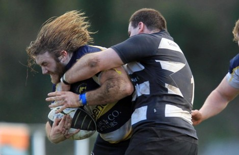 Dave Ryan of Dolphin tackled by Vinny Soden