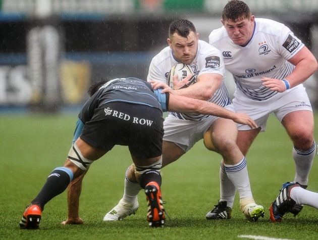 Cian Healy evades the tackle of Ellis Jenkins
