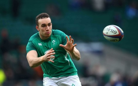 Ultan Dillane warms up before the match