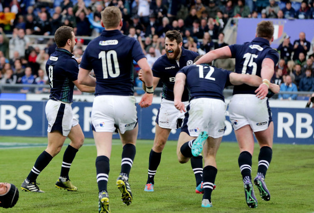 Scotland players celebrate a late Tommy Seymour try