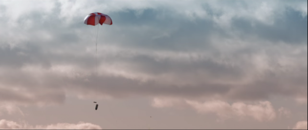 after-snagging-the-drone-in-the-net-a-parachute-is-deployed-to-bring-the-drone-back-to-earth-without-getting-damaged