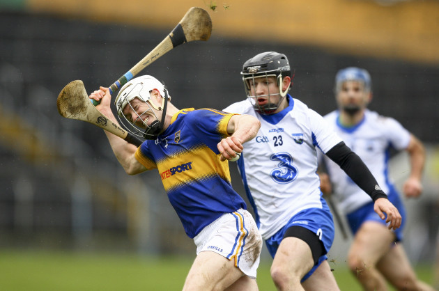 Michael Cahill is tackled by Mikey Kearney