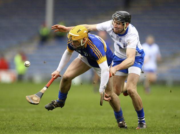 Liam McGrath is tackled by Barry Coughlan