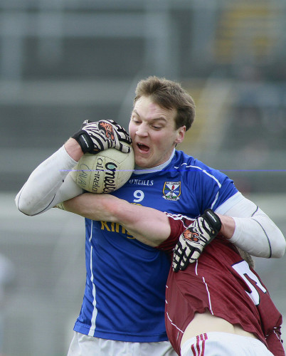 Gearoid McKiernan tackled by Paul Varley