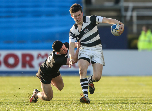 Hugh O'Sullivan tackled by Philip O'Shea