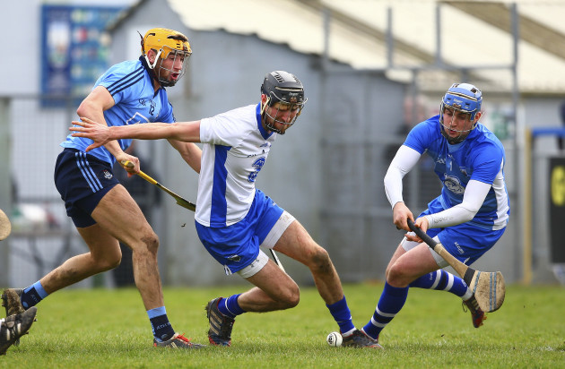 Stephen OÕKeeffe and Shane Fives tries to clear under pressure from Eamon Dillon