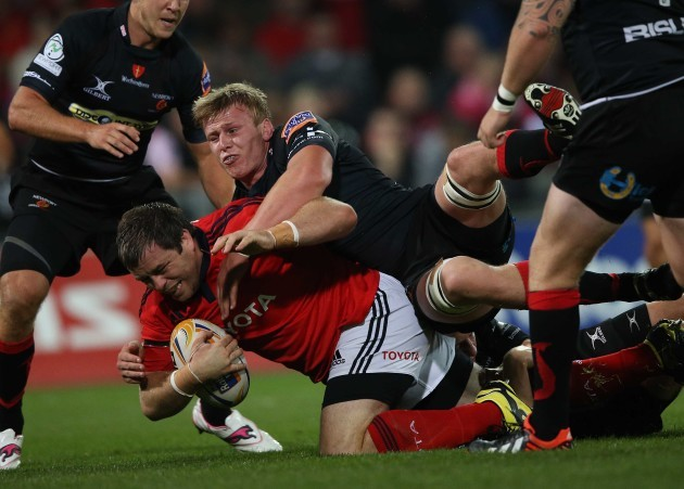 Munster's Marcus Horan tackled by Dragon's Ashley Smith Mandatory Credit ©INPHO/Billy Stickland
