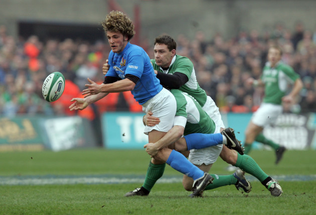 Mirco Bergamasco of Italy is tackled by David Wallace and Gordon D'Arcy of Ireland 4/2/2006