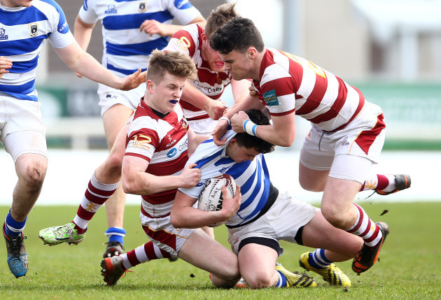 James Hill, Jake Gallagher and Conal Fallon tackle Frank Hopkins