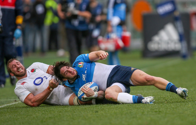 Italy's Michele Campagnaro is tackled by England's Chris Robshaw