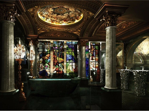 rooms-will-also-come-complete-with-stained-glass-and-marble-bathrooms-where-ceilings-illuminated-with-artwork-are-lit-by-a-standing-candelabra-a-rain-shower-is-hidden-behind-a-floor-to-ceiling-stained-glass-facade