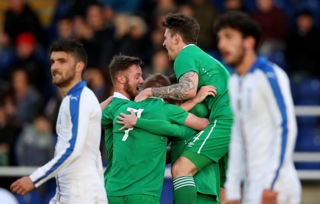Republic of Ireland players celebrate the opening goal