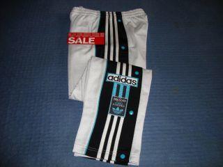 157050455_adidas-3-stripes-basketball-pull-tear-off-popper-joggers