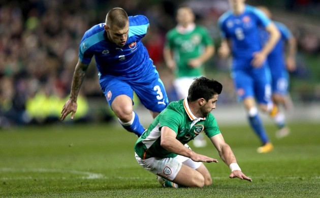 Shane Long is brought down for a second penalty by Martin Skrtel