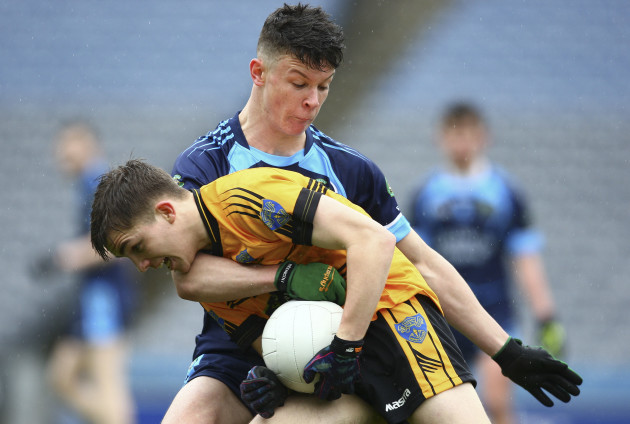 Rory Cunningham is tackled by Luke Gavin