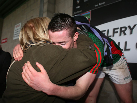 Stephen Coen hugs his mother Mary before he lifts the cup