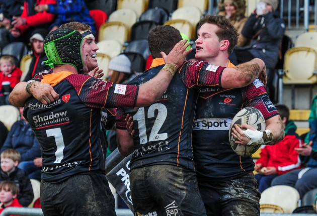 Hallam Amos celebrates scoring his side's second try with teammates