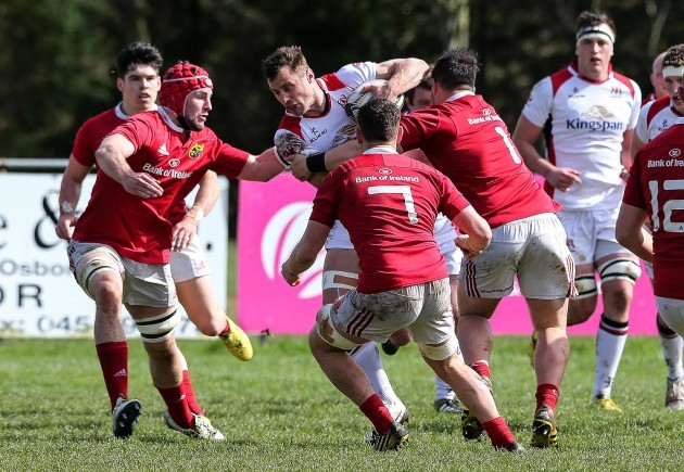 Tommy Bowe under pressure from the Munster defence