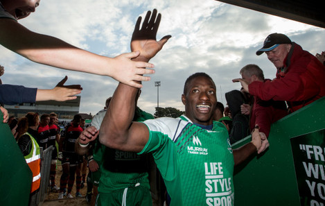 Niyi Adeolokun celebrates after the game