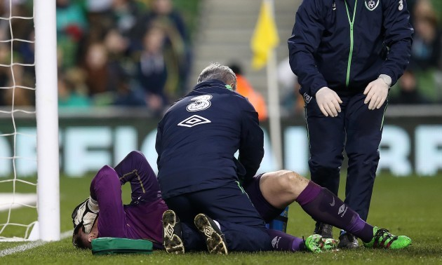 Rob Elliot is treated for an injury before being taken off