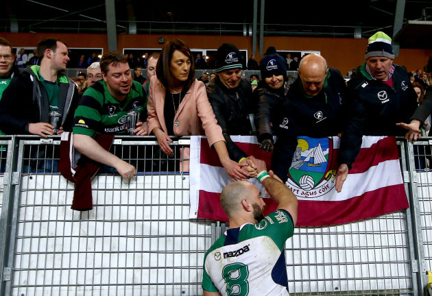 John Muldoon shakes hands with fans after the game