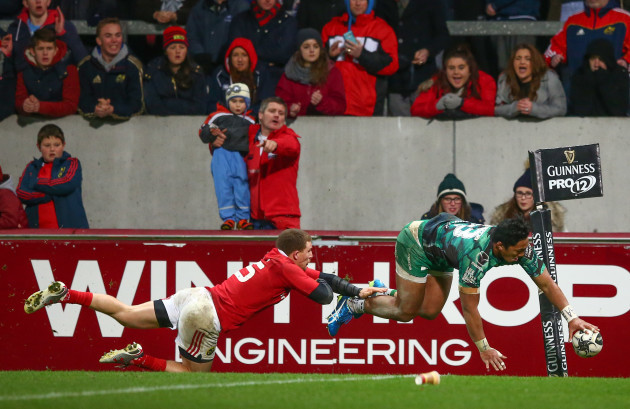 Bundee Aki scores his side's second try despite Andrew Conway