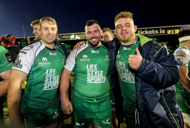 Fionn Carr, JP Cooney and Finlay Bealham celebrate at the final whistle