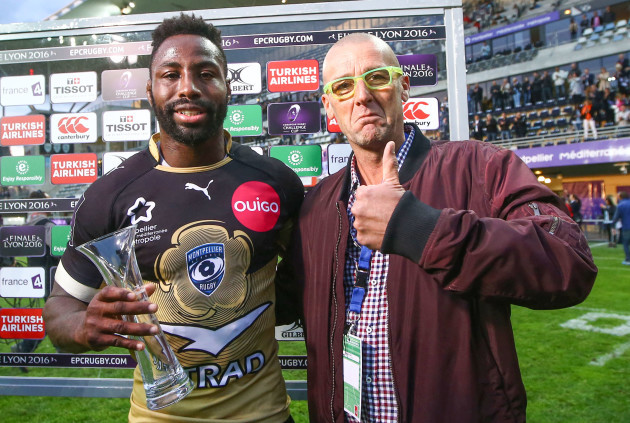 Fulgence Ouedraogo receives the man of the match from Heineken representative Pierre Agostini