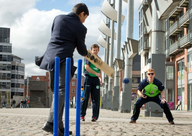 Ed Joyce and Kevin O'Brien bowl to members of the St Vincent's College Castleknock 1st year cricket team