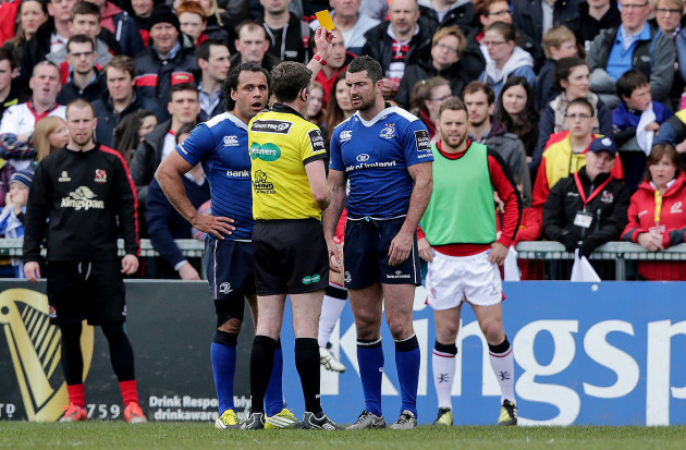 George Clancy shows a yellow card to Rob Kearney