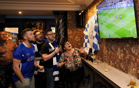 Leicester Fans watch Manchester United v Leicester City