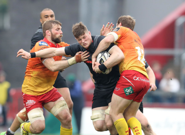 Jack O'Donoghue is tackled by John Barclay and Hadleigh Parkes