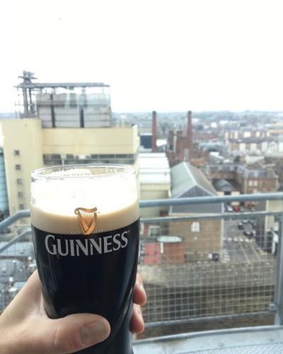 Enjoying a Guinness above the brewery #guinness #stjamesgate #guinnessstorehouse #dublin #ireland