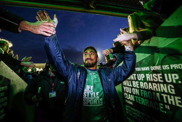 Bundee Aki celebrates with fans at the end of the game