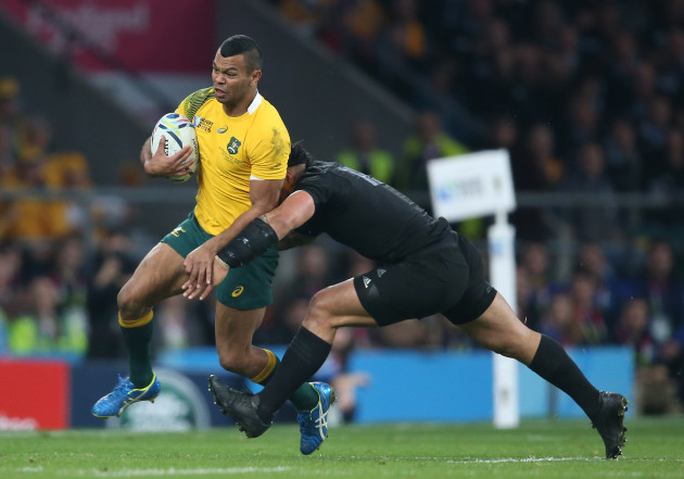 AustraliaÕs Kurtley Beale is tackled by New ZealandÕs Ma'a Nonu