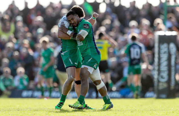 Tiernan O'Halloran celebrates with Bundee Aki after Niyi Adeolokun scored the opening try