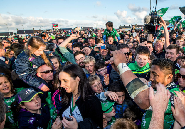 Bundee Aki surrounded by fans after the game