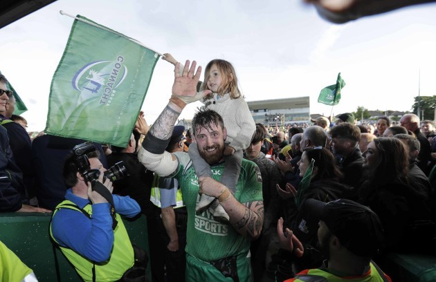 Aly Muldowney with his daughter celebrates at the end of the match