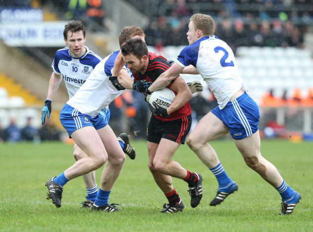 Mark Poland is tackled by Kieran Duffy and Colin Walshe